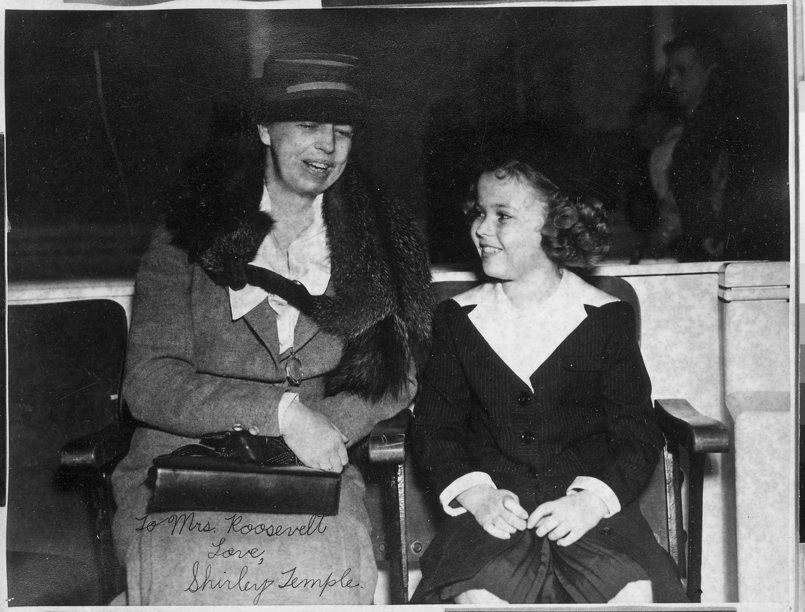 "Shirley Temple and Eleanor Roosevelt on set of ""Little Miss Broadway"""